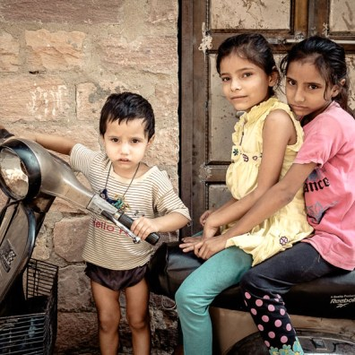 Three kids on bike
