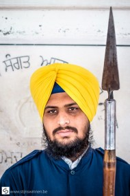 Guards at the Golden temple can be recognised by the yellow turban and the long spear.