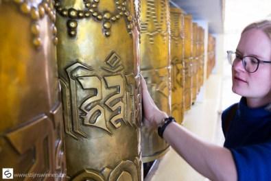 Turning the prayer wheel at the Dalai Lama temple