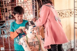 Children decorating a statue in the pagoda