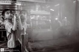 Reflection of boy looking in aquarium