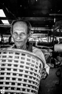 Man holding basket at fishmarket