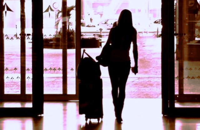 woman-leaving-luggage-airport