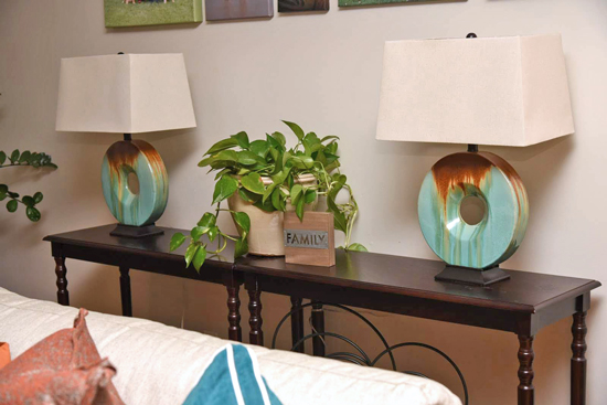 Family Room - Console with Teal Lamps and Indoor Plant