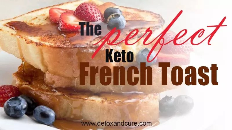 The Perfect Keto French Toast Recipe - image of a stack of golden brown french toast covered in a generous drizzle of maple syrup on a white plate which has been garnished with sliced strawberries and whole blueberries