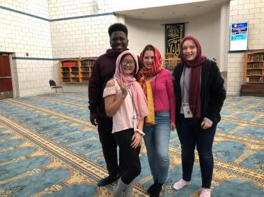 Students at mosque with head scarves