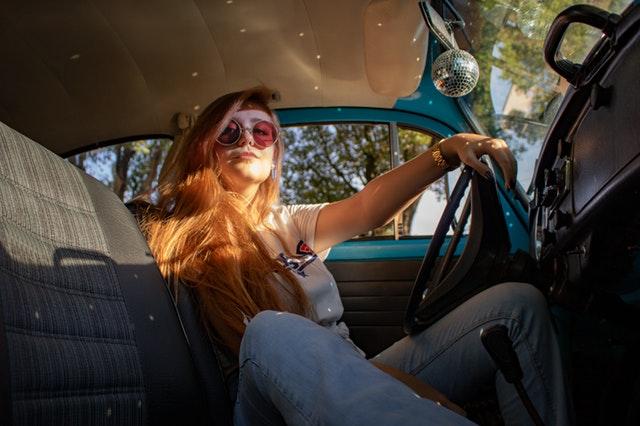 woman sitting in car
