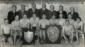 Back row: Ernest Chadwick, Bob Lewis, Norren Didsbury, George Baxter, John Cleworth, T Pocklington (baths superintendant), Cornelius Dawson; front row: Tommy Kelly (kneeling), Brian Roberts, Lawrence Sims, John Neary, Jack Whittaker, Don Jenkinson, Harley Anderson, John Dandy, Stan Lewis; front: Jim Welsby In 1954 Tyldesley S&WPC won both the Bolton and District and the Manchester and District First Division Water Polo Championships and won the Manchester and District the following year.