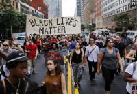 Thousands of New Yorkers Protest Police Shootings of Black Men