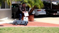 Flying courier drone can drive up to your door