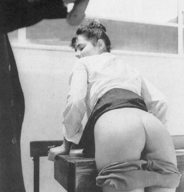 Bend over spank exam