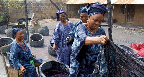 2 Indigo dyers at Nike Centre for Art & Culture, Oshogbo, Nigeria. Photo copyright Mary Lance