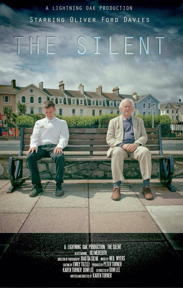 The Silent poster for the short film. Two men sitting on a bench in Teignmouth