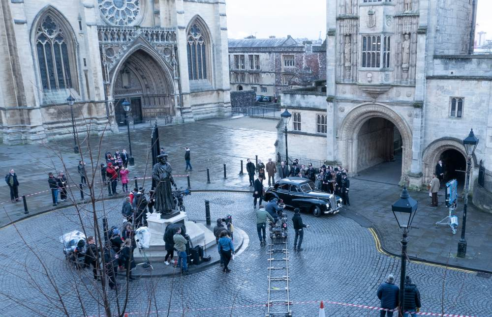 a birds eye view of filming in a square in bristol