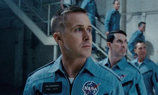 ryran reynolds lined up in a nasa blue shirt