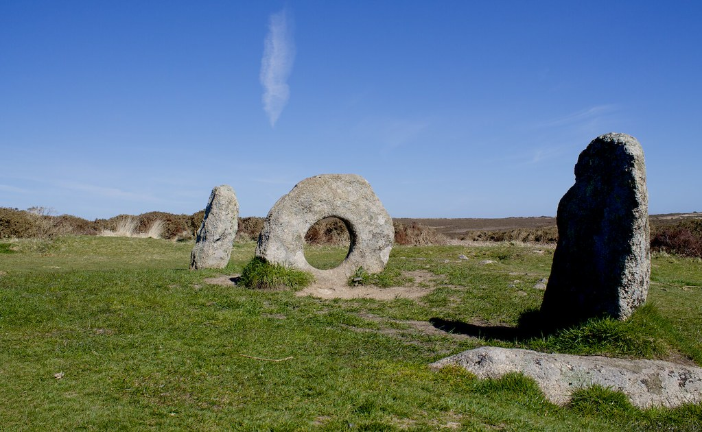 a circular stone in line with some standing stones