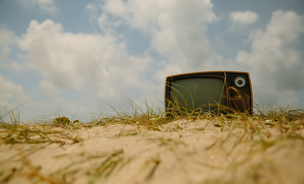 a tv on a sand dune