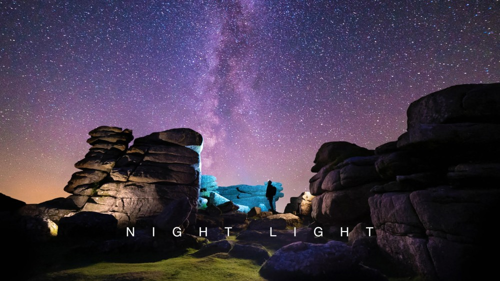 a image of Dartmoor at night with a purple and dark blue sky