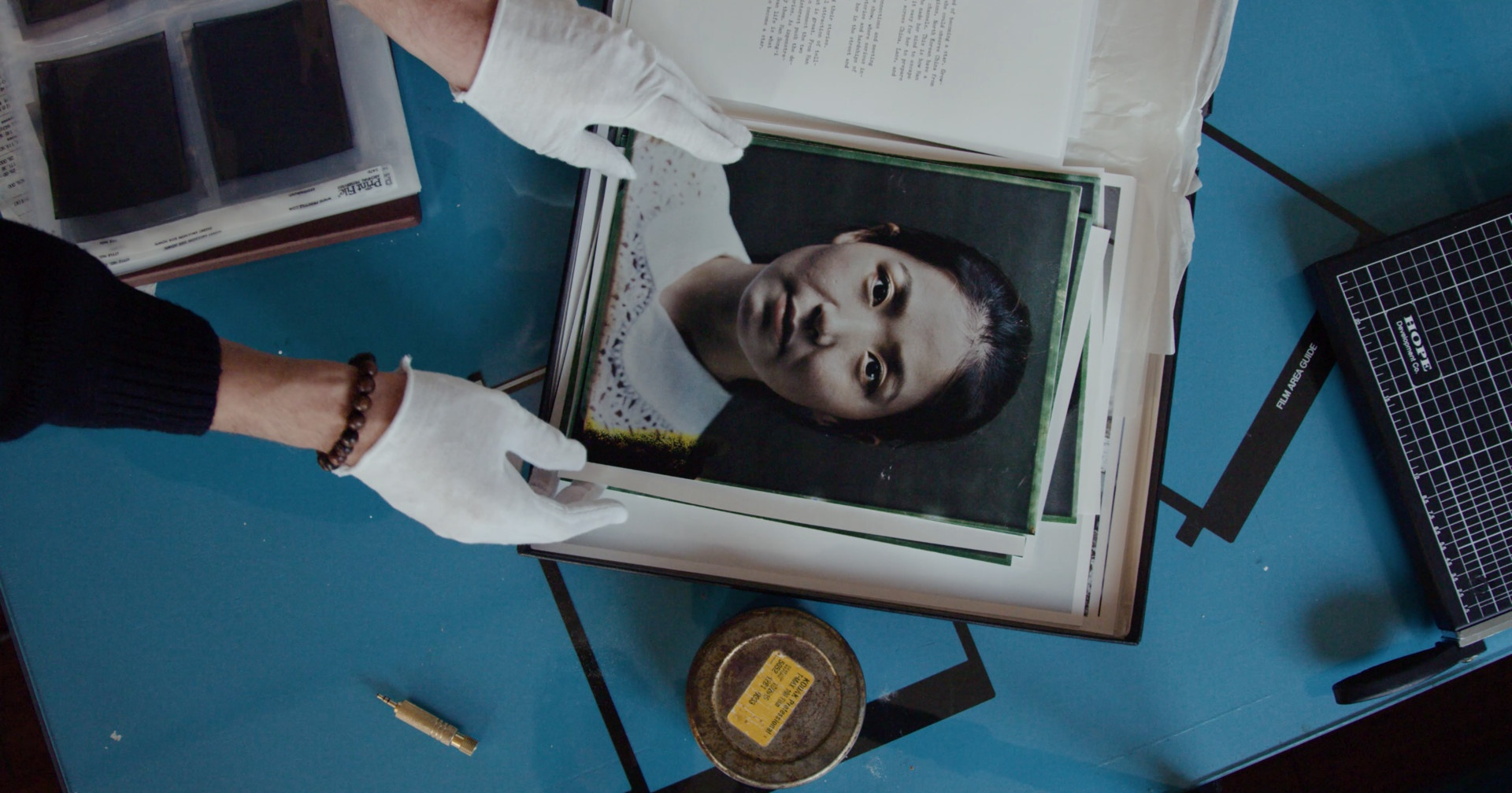 a screen shot from reclaiming the negative. a portrait of a woman in a frame on a desk