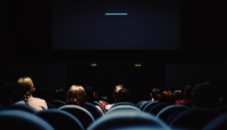 a cinema from the back seeing people in seats