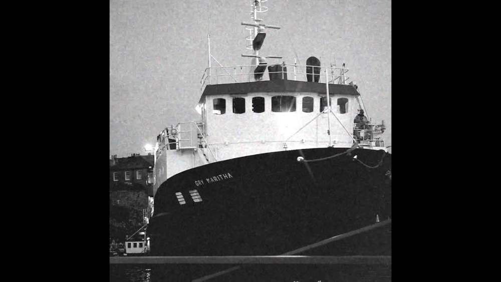 black and white picture of the front of a boat launching from Penzance dry dock