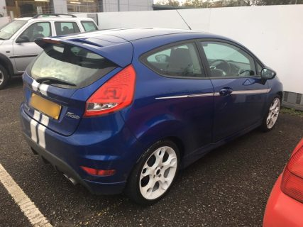 Ford Fiesta with standard green factory glass