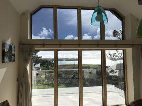PerLite 20 window film installed, internal view, uppers windows tinted.
