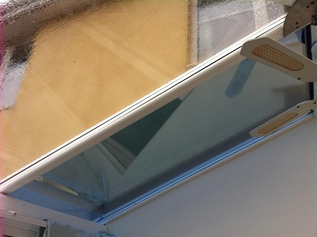 Johnson Architectural MBL 20 window film on a conservatory roof in Paignton. Heat and glare reduction along with striking colour