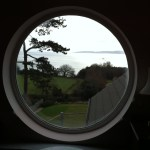 Round window prior to having window film applied to reduce heat and glare