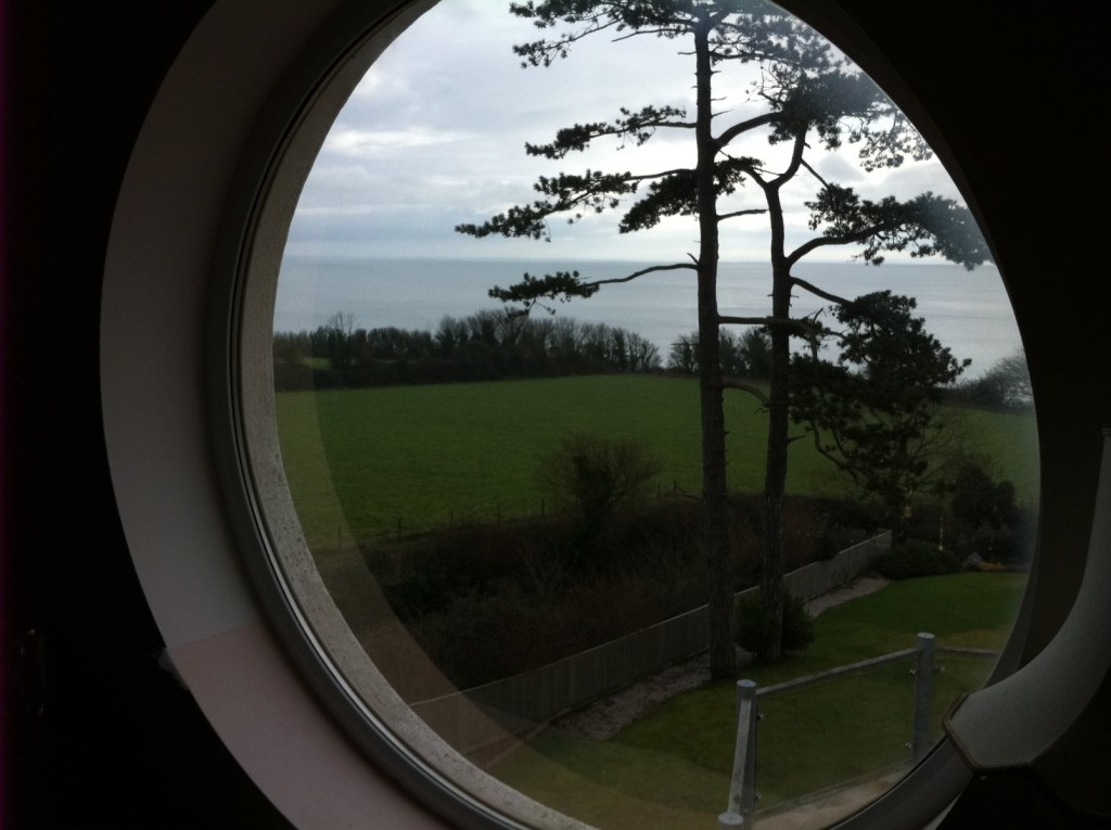 Window film applied to a round window to reduce heat and glare in Teignmouth