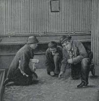 3 men playing dice