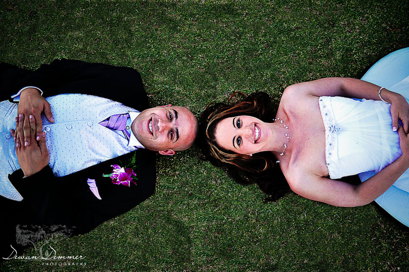 Newly Wed couple, lie on the grass