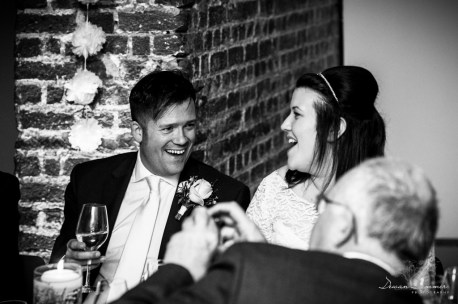 bride and groom share a laugh
