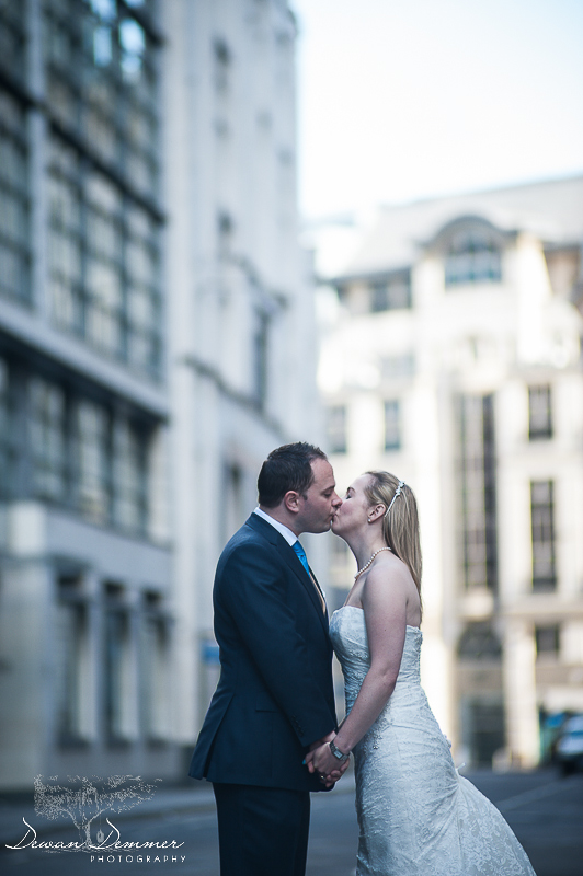 London Wedding Photography of Bride and Groom kissing in the middle of the road in London
