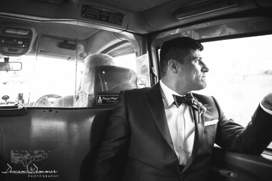 Groom stares out window on way to wedding