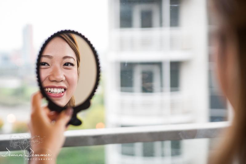 brides-reflection-in-mirror-during-prep