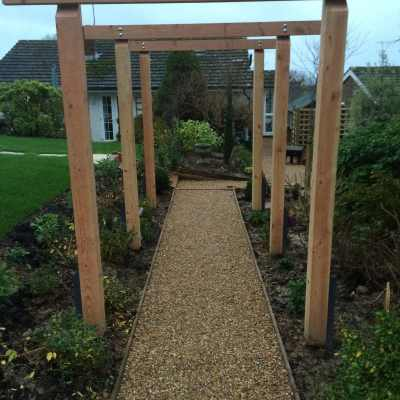 View through pergola to bungalow end of garden, Littlewood, Sussex