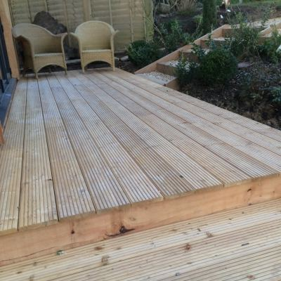 Natural larch deck area for garden room, Littlewood, Sussex