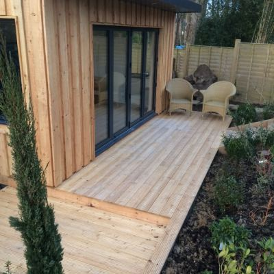 Natural larch-clad garden building and deck, Littlewood, Sussex