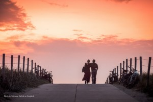 couple walking in sunset w credit