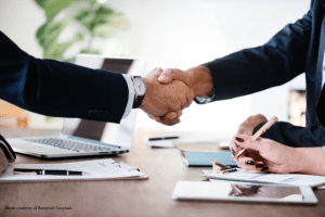 men shaking hands represents selling business with Rawpixel credit