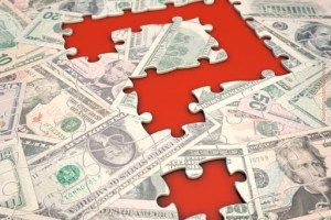puzzle with red background represents cash flow
