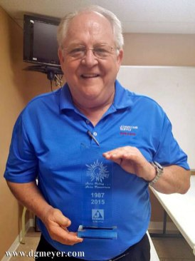 Mark Middleton from Johnstone Supply presenting glass plaque for