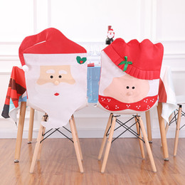 christmas chair back covers uk revolving without shop kitchen santa claus cap non woven cover for home dinner decoration red