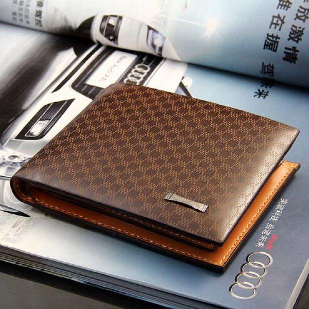 Brown men's wallet on top of table