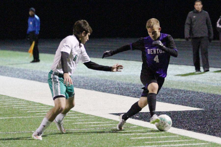 Junior Wes Kohler dribbles past a Hornet defender during the Broncos' win Friday in Azle.