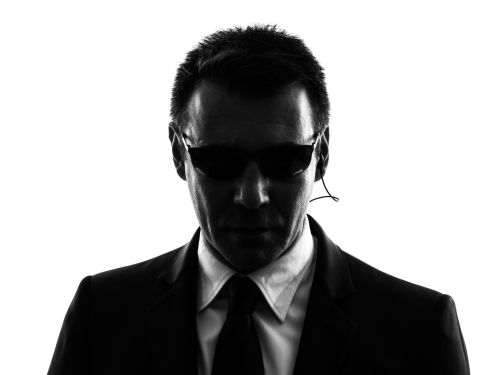 36946082 - one secret service security bodyguard agent man in silhouette on white background