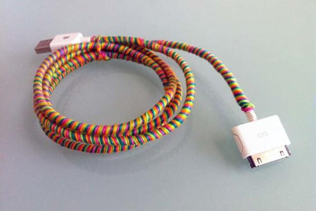 To keep a phone charger from getting tangled up, wrap it in colorful embroidery floss.