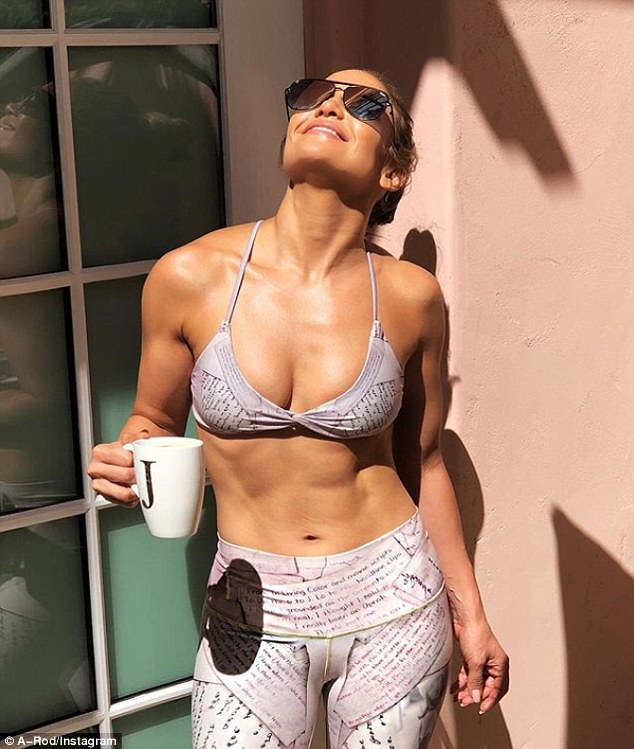 Ripped and rad: Jennifer Lopez treated her Instagram followers to a photo of her abs while in a bra top as she enjoyed her morning coffee in a J mug on Saturday