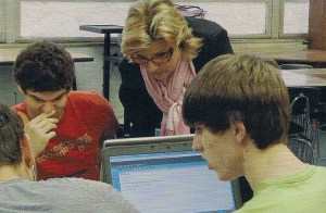 Debbie Pritchett assists students in calculus class.